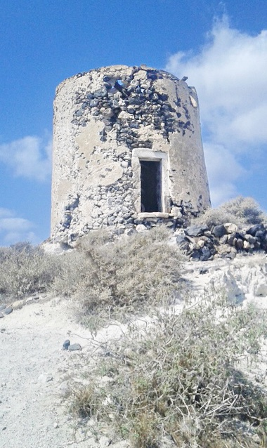 Windmill in Santorini with caves to remodel