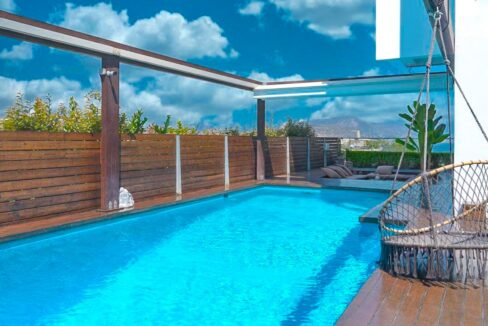 Apartment with a garden and a swimming pool, Varkiza Athens for sale. Luxury Property for sale near Vouliagmeni 18