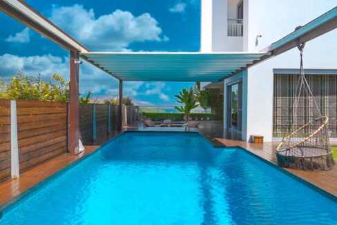 Apartment with a garden and a swimming pool, Varkiza Athens for sale. Luxury Property for sale near Vouliagmeni 20