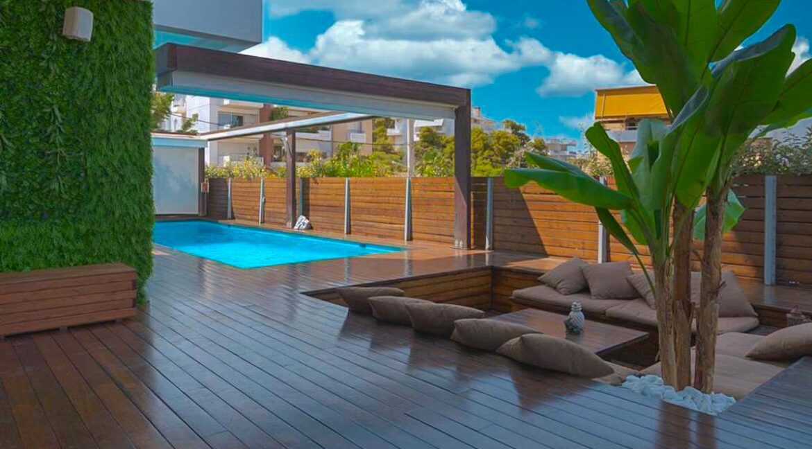 Apartment with a garden and a swimming pool, Varkiza Athens for sale. Luxury Property for sale near Vouliagmeni 22