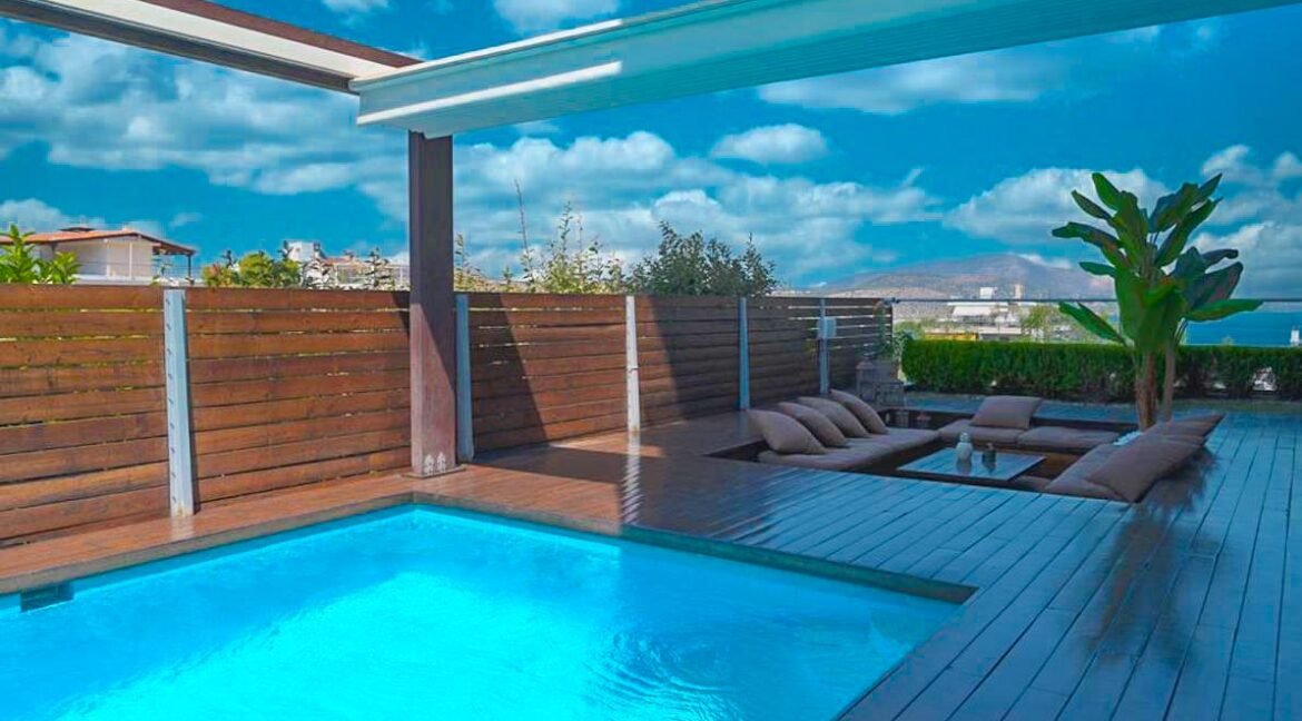 Apartment with a garden and a swimming pool, Varkiza Athens for sale. Luxury Property for sale near Vouliagmeni 25