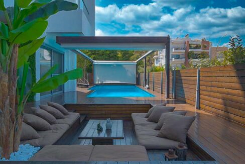Apartment with a garden and a swimming pool, Varkiza Athens for sale. Luxury Property for sale near Vouliagmeni 26