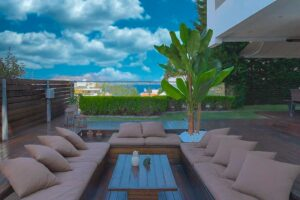 Apartment with a garden and a swimming pool, Varkiza Athens for sale. Luxury Property for sale near Vouliagmeni